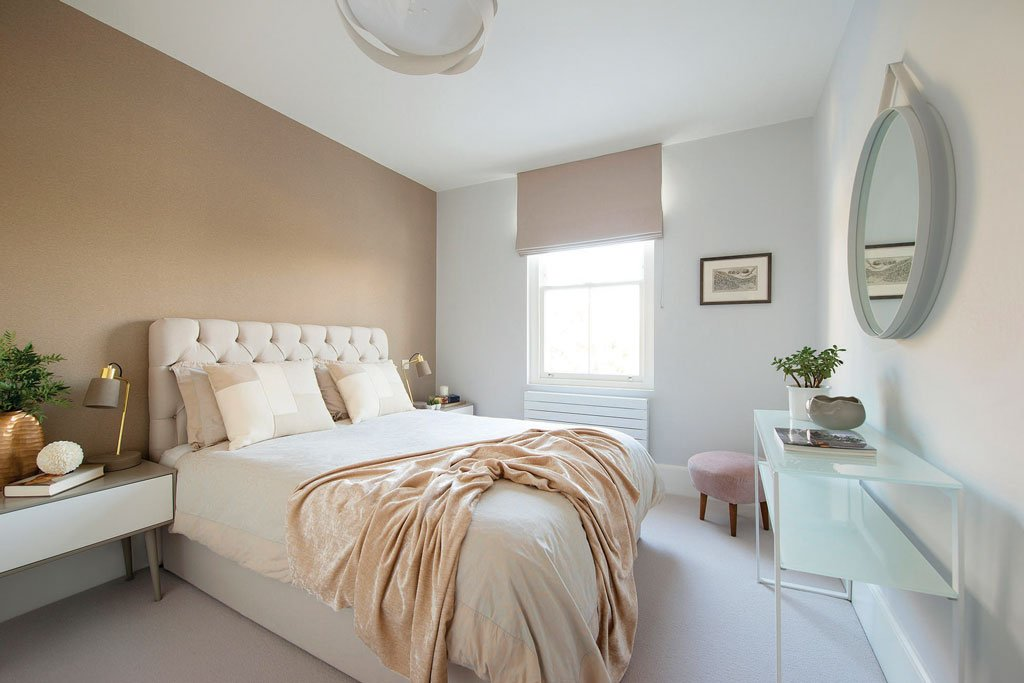 Soft neutral pastel colours for a relaxing guest bedroom