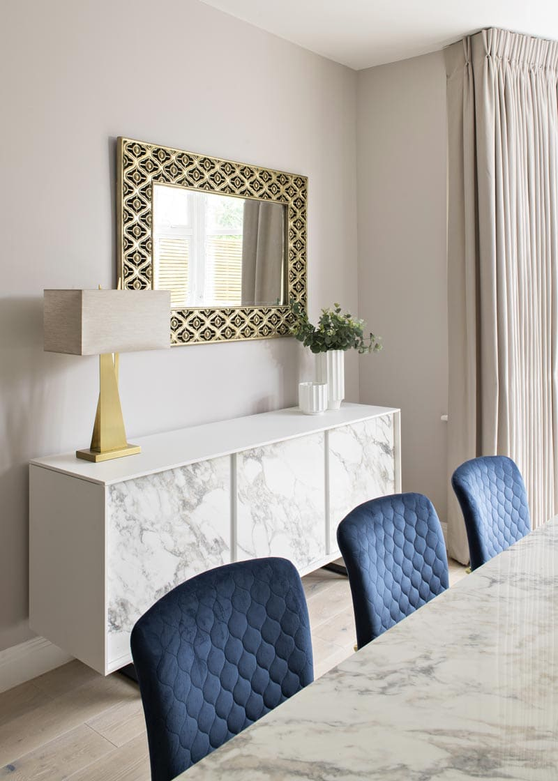 Contemporary dining room with marble table and sideboard in Kensington