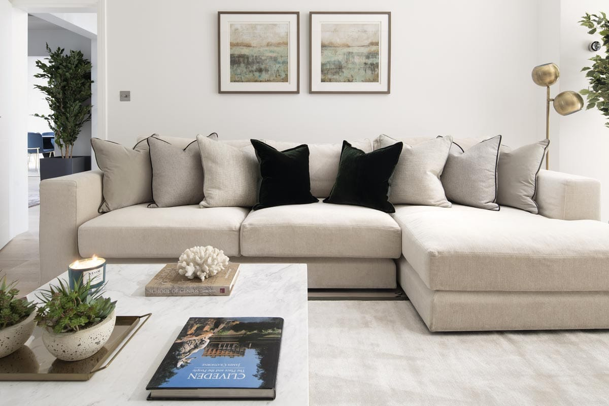Contemporary family room with a bespoke sofa and marble coffee table in Kensington