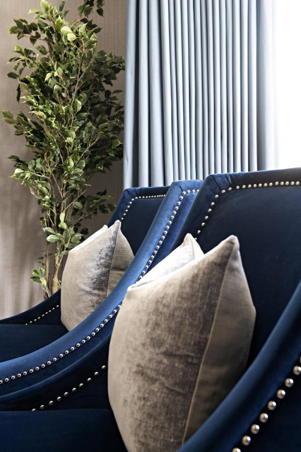 close up of blue armchair in a formal living room in Kensington