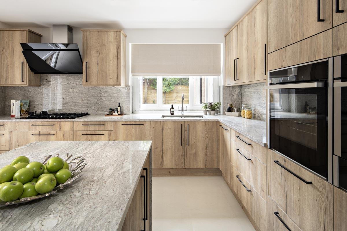 Contemporary kitchen with quartz island in Kensington