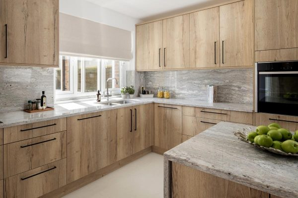 Contemporary kitchen with quartz island in Kensington