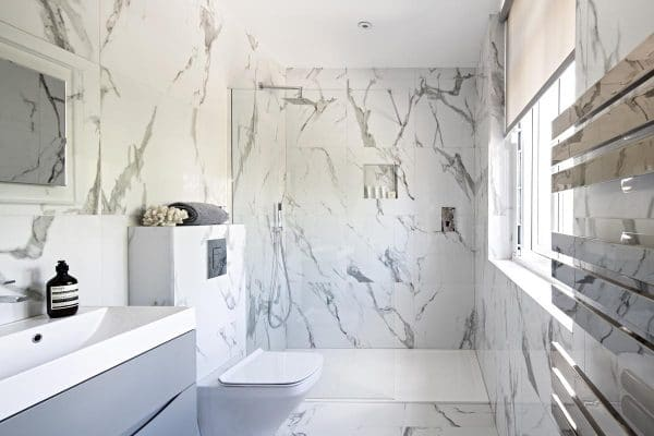 Family bathroom with marble effect porcelain tiles in Kensington with walk in shower