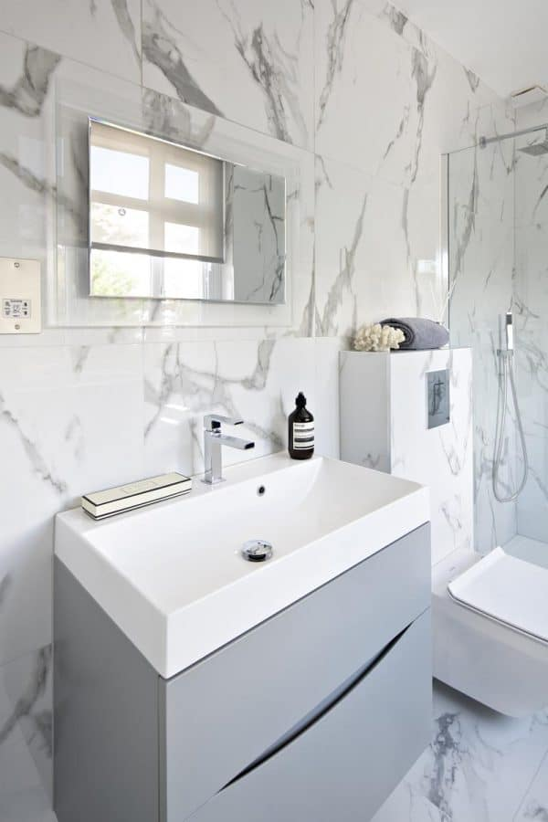 Family bathroom with marble effect porcelain tiles in Kensington