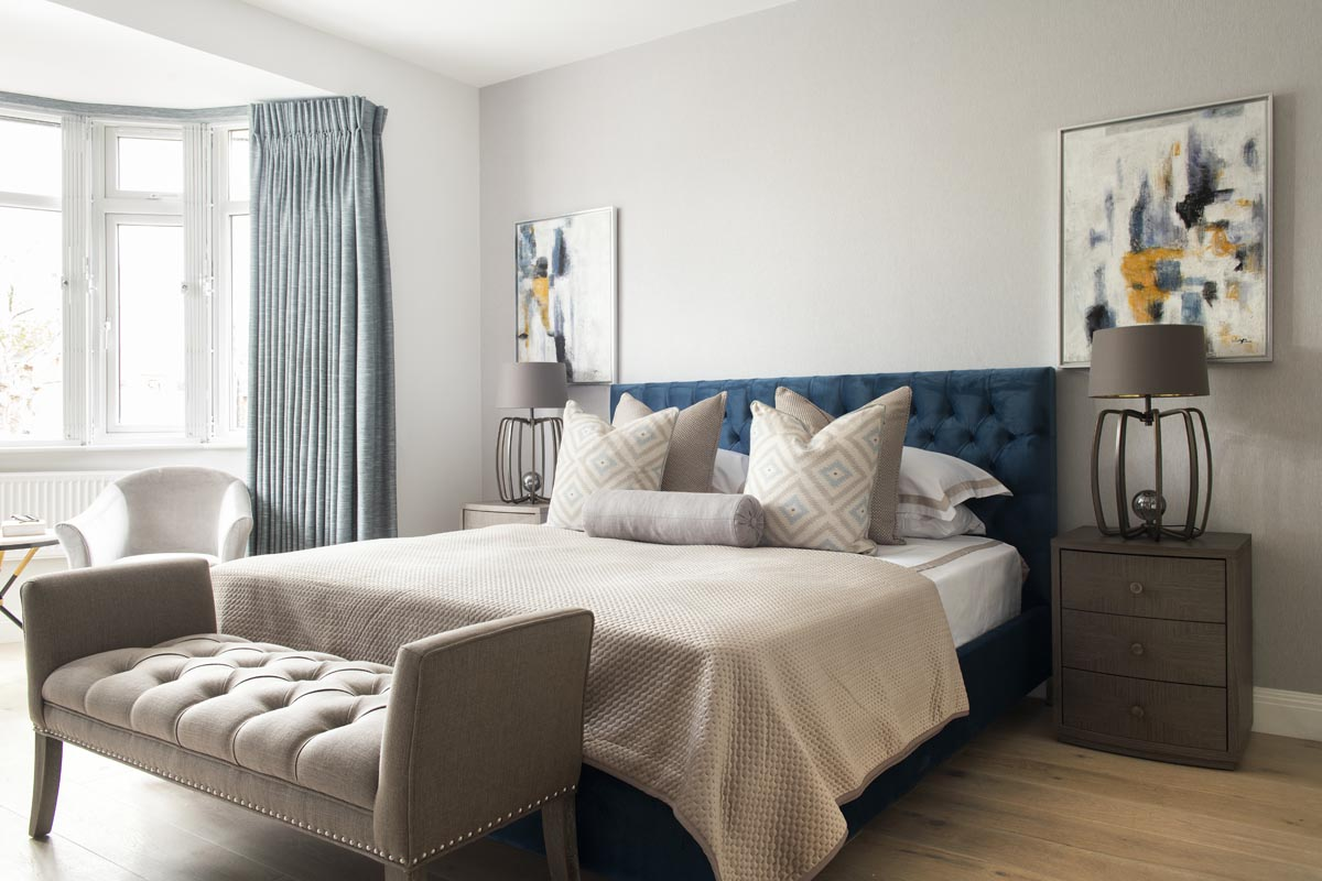 Contemporary master bedroom in Kensington in blue and grey color