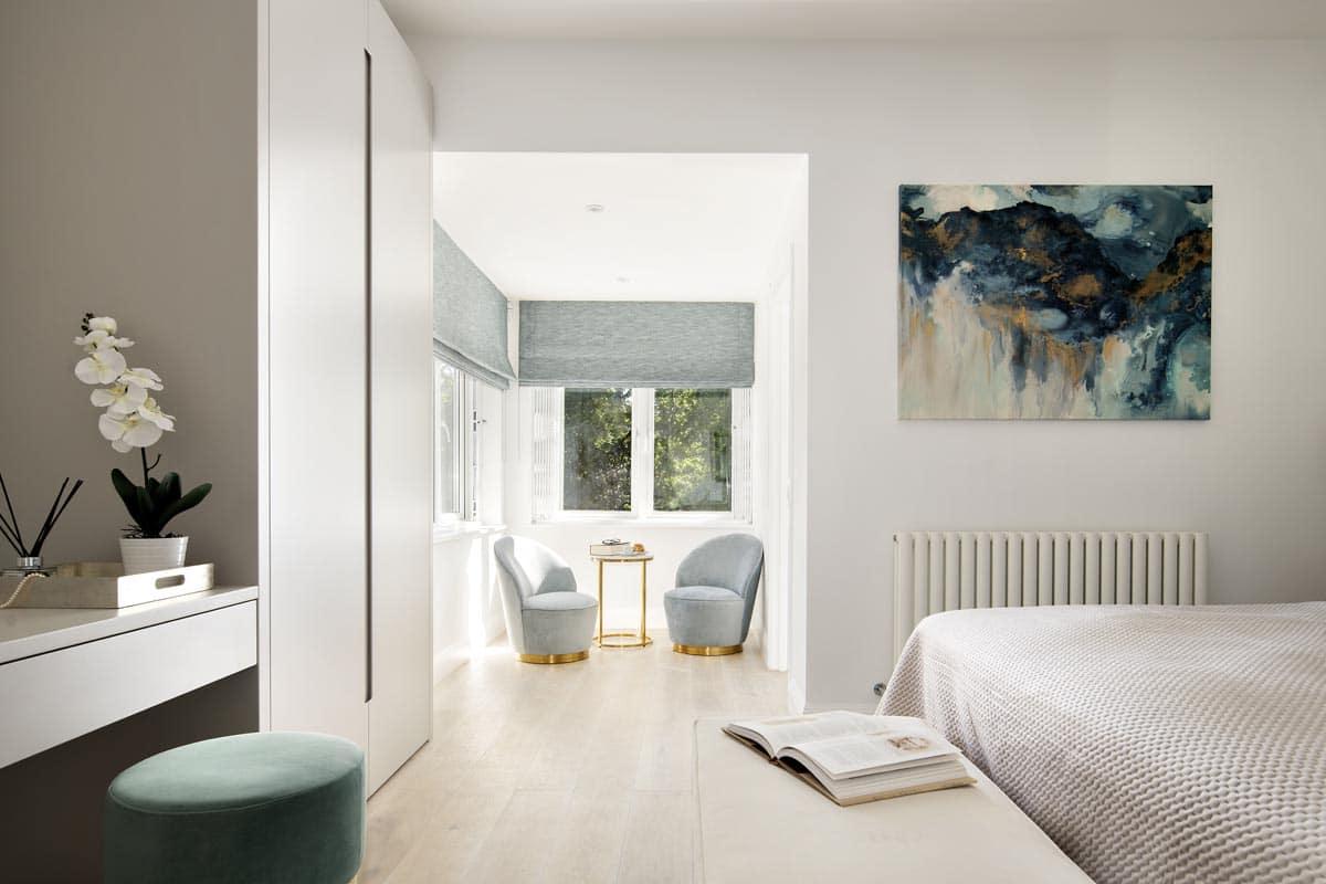 Contemporary master bedroom in duck egg color in Kensington
