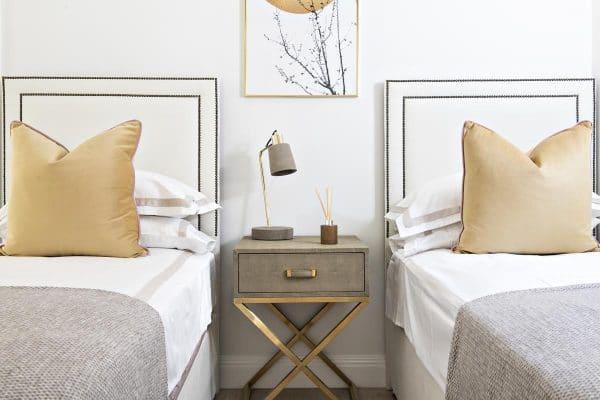Twin bedroom with mustard color in Kensington