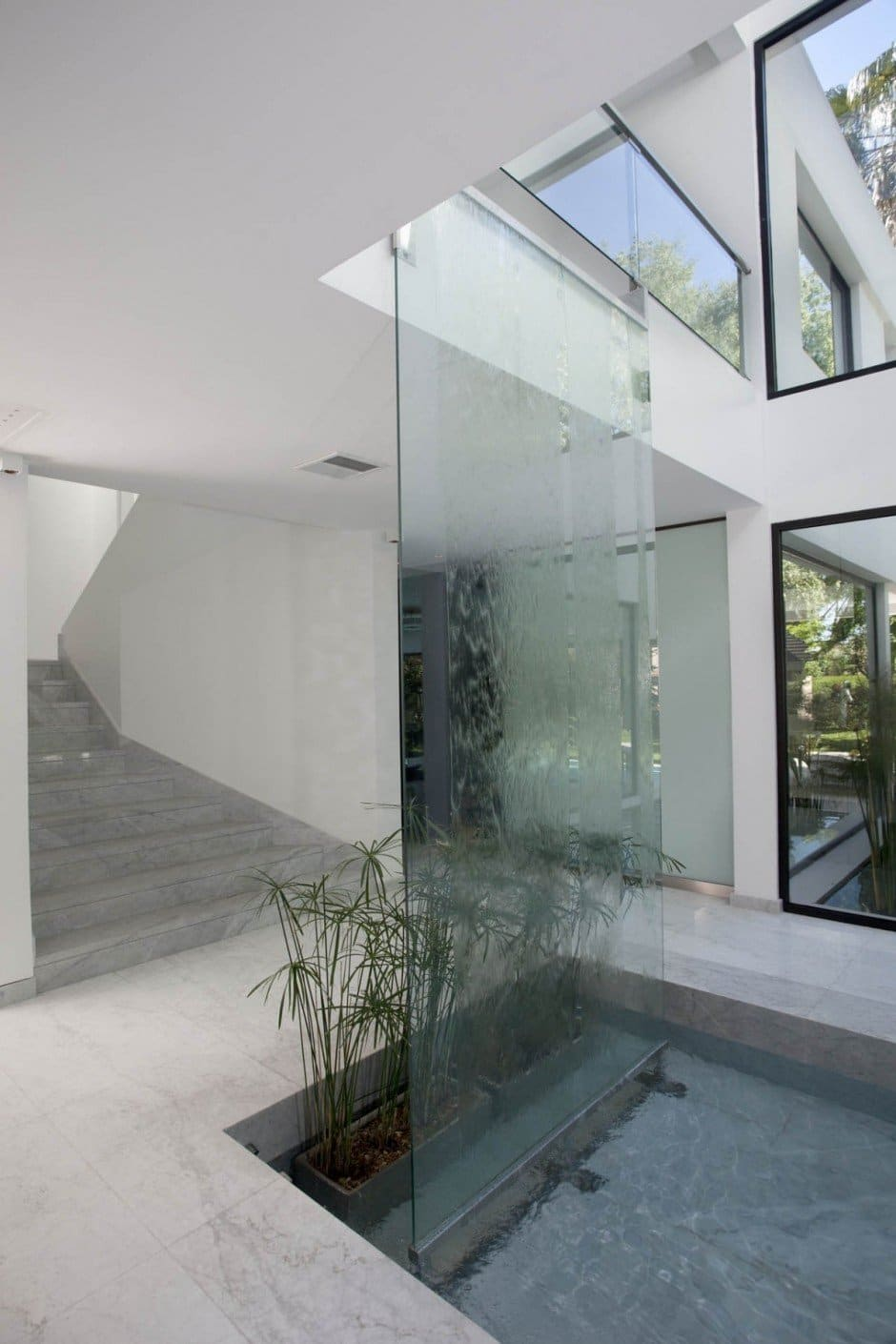 Carrara House waterfall showcasing water features by designer unknown