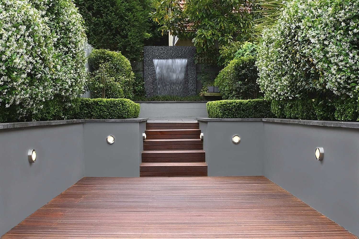 Luxury garden with waterfall, lights and wooden stairs